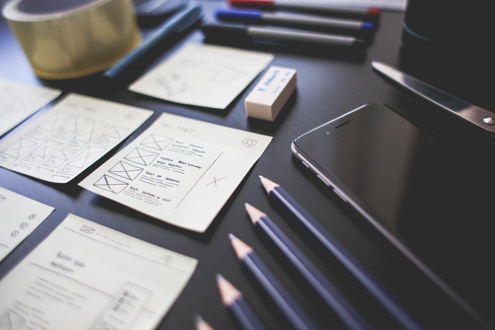 a desk being used for website design at ShopMonster