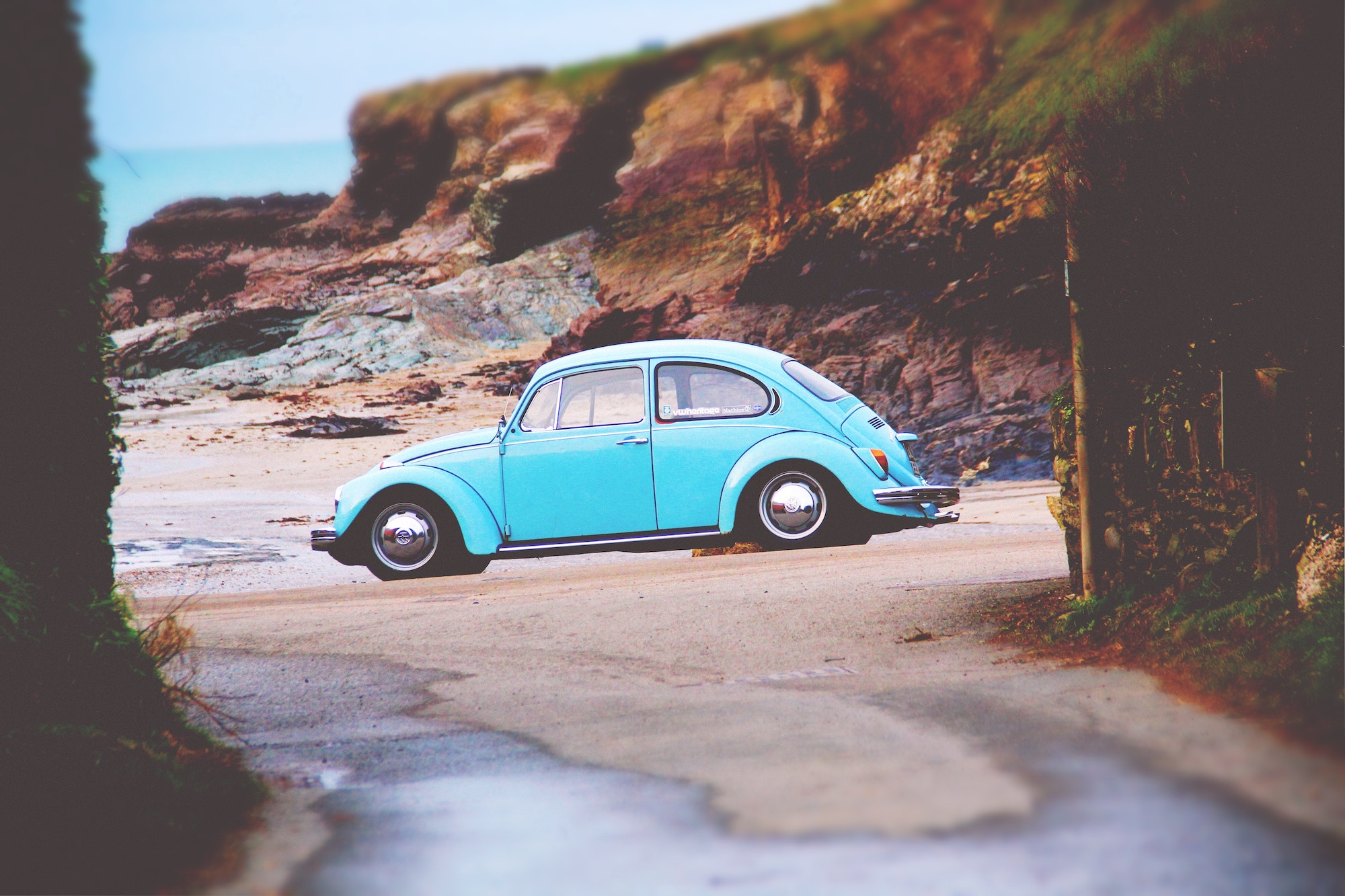 a VW Beetle parked on the beach near Padstow, Cornwall