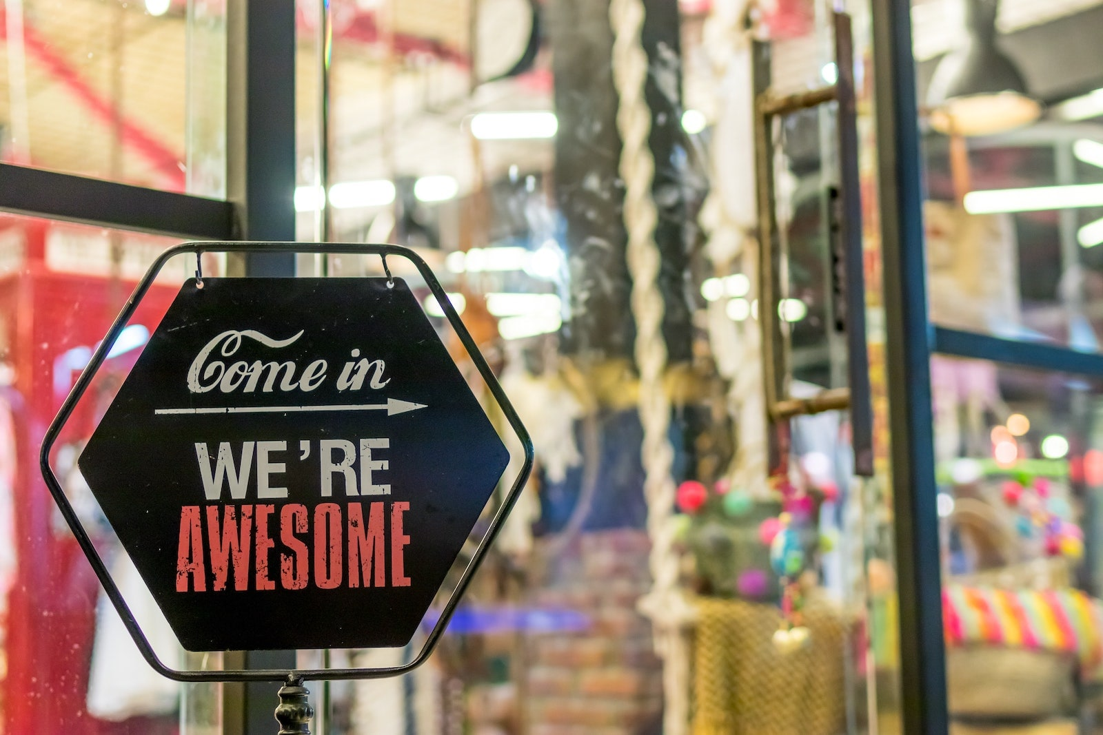 "shop front with ""come in we're awesome"" signage"